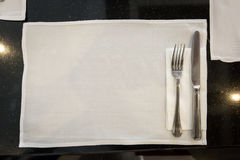 Spoon and fork on napery Royalty Free Stock Photography