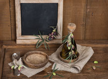 Spoon,fork and olives and olive oil, menu black blackboard on Stock Images