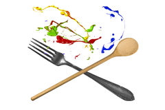 Spoon and fork with paint above Stock Photography