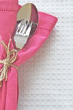 Spoon and Fork with pink serviette Stock Images