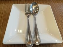 Spoon and fork. On plate for dinner royalty free stock photography