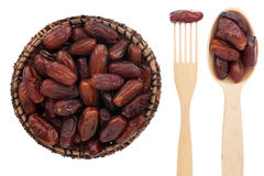 Spoon, a fork, a plate with dried date Stock Photo