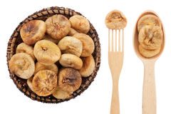 Spoon, a fork, a plate with dried figs Royalty Free Stock Images