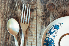 The spoon, a fork and a plate Royalty Free Stock Photo