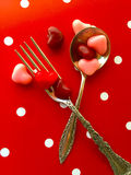Spoon and fork with Valentine heart candies Royalty Free Stock Photo