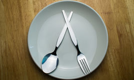 Spoon and fork. Were placed in a green ceramic plate. Flat lay photo Stock Photography