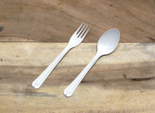 Spoon and fork on wooden Stock Photos
