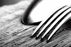 Spoon and fork on wooden background macro Stock Photo