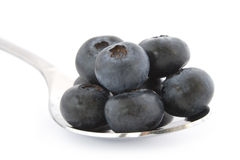 Spoon with fresh blueberries Stock Photography