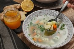 Spoon with fresh homemade soup t royalty free stock image