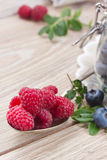 Spoon of fresh raspberries Stock Images