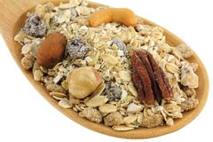 A spoon of Fruit, Nut, and Fiber Muesli Royalty Free Stock Image