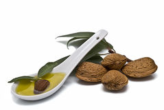 Spoon full of almond oil. Royalty Free Stock Photos