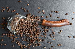 Spoon full of black peppercorn Royalty Free Stock Images
