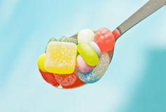 Spoon full of candy Stock Photo