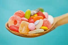 Spoon full of candy Stock Photos