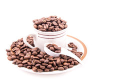 Spoon full of coffee beans Royalty Free Stock Photography