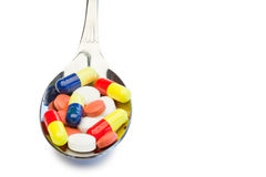 Spoon full of color medicine Stock Photos