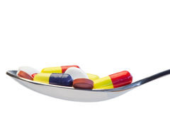 Spoon full of color pills Stock Photography