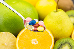 Spoon full of colorful pills Stock Photos