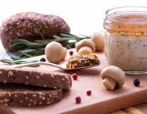 Spoon full of french mustard with chicken pate in jar and sliced bread. Royalty Free Stock Photos