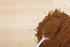 Spoon full of ground coffee and coffee beans on rustic wood Royalty Free Stock Photography