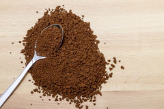 Spoon full of ground coffee and coffee beans on rustic wooden ta Royalty Free Stock Photo