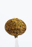 Spoon full of Lemon pepper against white background,close up Stock Photography
