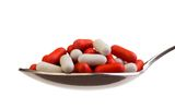 Spoon full of pills Stock Images