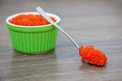 Spoon full of red caviar Stock Photos