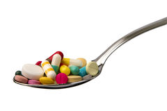 Spoon full of tablets Stock Images