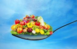 Spoon full of various fruit and vegetables Stock Photos