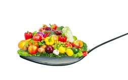 Spoon full of various fruit and vegetables Royalty Free Stock Photos