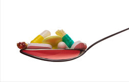 Spoon full of various pills Royalty Free Stock Photo