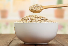 Spoon gaining oatmeal in bowl Royalty Free Stock Photography