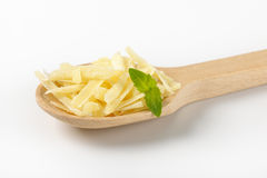 Spoon on grated parmesan Royalty Free Stock Photos