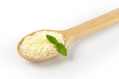 Spoon on grated parmesan Stock Image