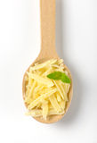 Spoon on grated parmesan Stock Photos