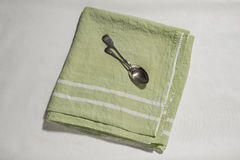 Spoon on Green Linen with White Stripes Stock Image