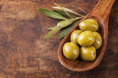 Spoon with green olives stock images