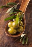 Spoon with green olives Royalty Free Stock Photography