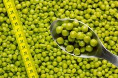 Spoon of Green Peas Royalty Free Stock Photos