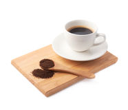 Spoon of ground coffee and cup on a plate Stock Photo