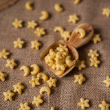 Spoon. Handcarved wooden spoon and stars Royalty Free Stock Images
