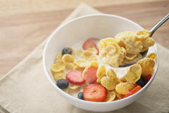 Spoon with healthy breakfast with corn flakes and berries. Slightly toned photo Royalty Free Stock Photos
