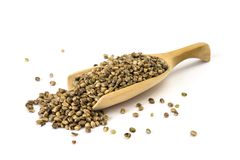 Spoon with hemp seeds Royalty Free Stock Images