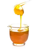 Spoon with a honey stream Stock Image