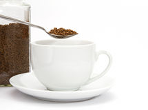 Spoon of instant coffee granules with cup Stock Photos