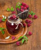 Spoon in jar of raspberry jam Royalty Free Stock Photography