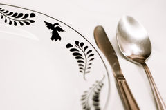 Spoon, knife and  decorated plate Royalty Free Stock Photo